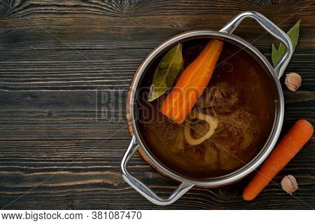 Beef Meat Broth, Ossobuco On Bone, Rich Soup In Saucepan, Long Slow Languishing Cooking.