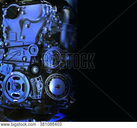 The Powerful Engine Of A Car In Blue Tone On Black Background With Copy Space