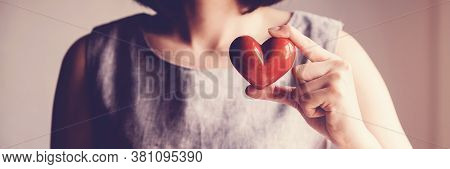 Woman Holding Red Heart, Health Insurance, Donation Charity Concept, World Health Day, World Mental