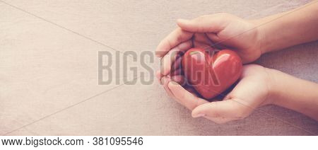 Hands Holding Red Heart, Health Care, Love, Organ Donation, Family Insurance,csr,world Heart Day, Wo