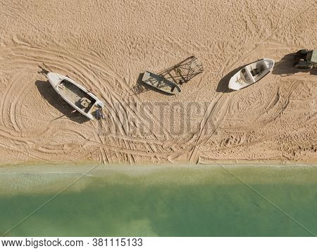 Aerial Of A Traditional Fisher Boats On A Sand Beach. Landscape With Sailboats, Clear Sea. Seascape