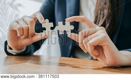 Business Woman Hands Connecting Jigsaw Puzzle. Business Solutions, Success And Strategy Concept.