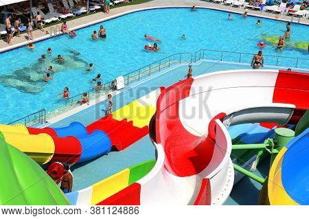 Dnipro City, Ukraine, 2018 07 10. Colorful Roller Coasters In The Picturesque Water Park. Resort In