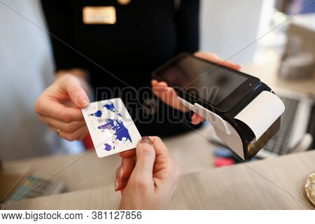 Client Holds Out Credit Card For Payment Terminal. Seller Offers Buyer To Pay By Credit Card. Connec