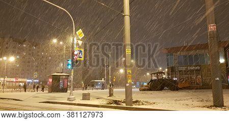 Russia, St. Petersburg 06.12,2018 Snowfall At Night In The City Streets