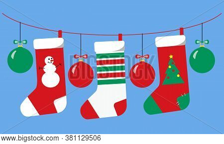 Garland Of Hanging Christmas Socks And Balls Of Red Green And White. New Year And Christmas Gorizont