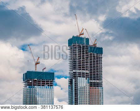 Construction Work Site And High Rise Building. High-rise Building Under Construction. Reinforced Con
