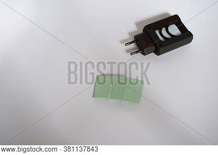 Black Electric Fumigator And Repellent Plates On A White Background.