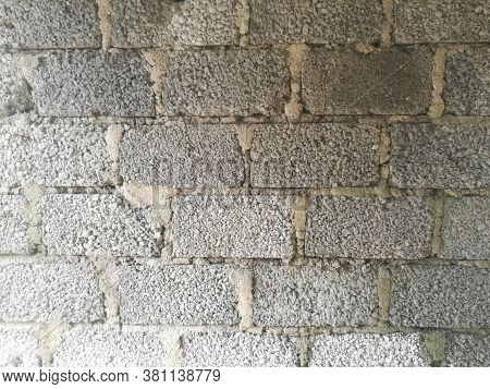 A Wall Made Of Cement Blocks And Concrete Like Texture.each Block Is Differentiated By The Concrete