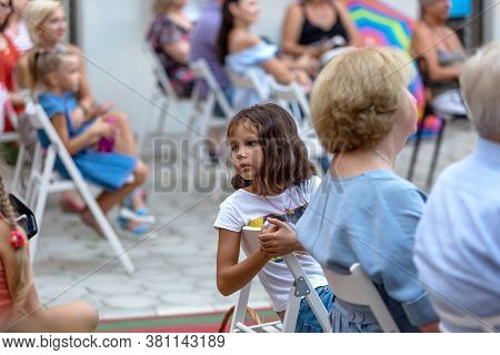 Odessa, Ukraine - Circa 2020: Selective Focus. Spectators-children In Summer Theater During Popular