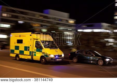 London Emergency Ambulance Responding At Night With Blue Lights And Motion Blur In London, England,