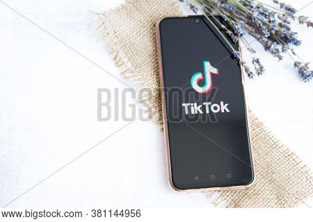 Tver, Russia-august 5, 2020, The Tik Tok Logo On The Smartphone Screen On Light Background With Lave