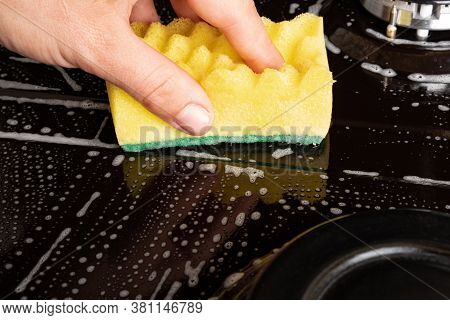 Washing The Gas Plate With A Washcloth And Detergent. Cleaning The Kitchen .