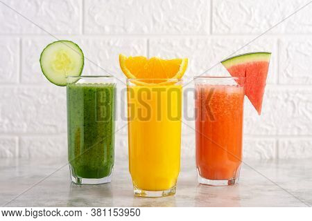 A Glass Of Orange Juice With Slice Of Orange, Watermelon Smoothie With Slice Of Watermelon And Spina