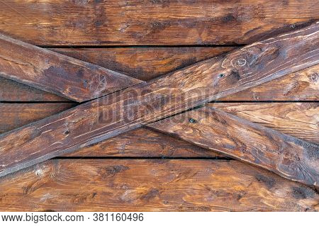 Old Wood Surface With Criss-cross Details. Brown Planks Of Aged Textured Board Material With Cracked
