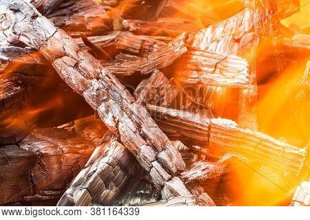Burning Wood Chips Forming Coal. Barbecue Preparation, Fire Before Cooking. Hot Coal Made Of Greatly