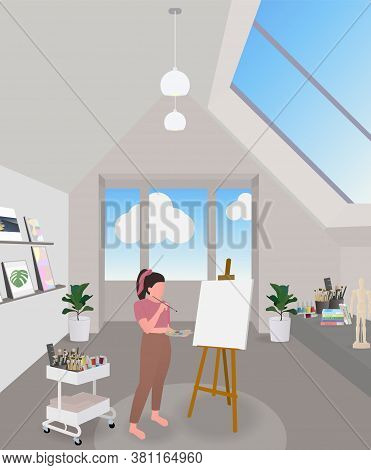 Woman Using Weekend Holiday With Drawing At Art Room. The Art Room Has Models. Many Colors And Brush