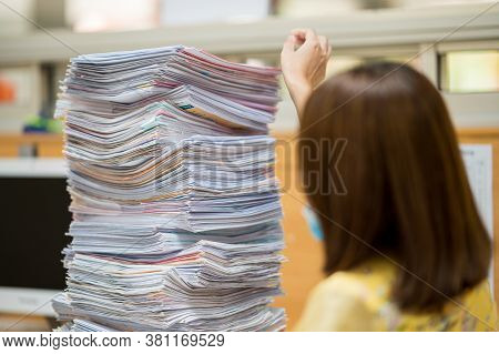 Shot Of Stacked File Document Folders On Office Desk