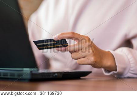 Close Up Woman In Cafe Shopping Online With Laptop