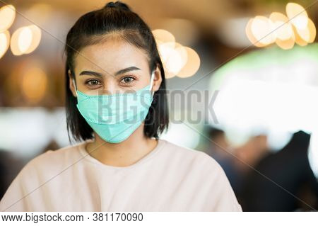 Close Up Portrait Face Woman Wearing Surgical Mask For Prevent Dust And Infection Virus.