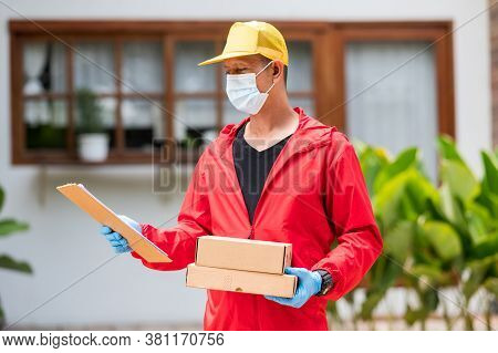 Deliverdelivery Man Wearing Blue Gloves In Red Cloth Holding Cardboard Boxesy Man Wearing Blue Glove