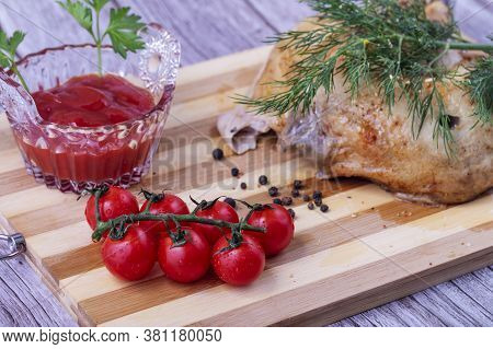 Delicious Cooked Chicken With Tomatoes And Seasonings.the Concept Of Delicious Food.