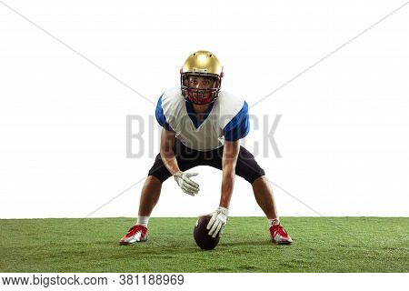 In Action. American Football Player Isolated On White Studio Background With Copyspace. Professional