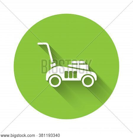 White Lawn Mower Icon Isolated With Long Shadow. Lawn Mower Cutting Grass. Green Circle Button. Vect