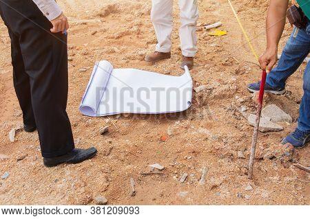 Architect Plans Surveying Prepare Work Construction New Building On Land Empty