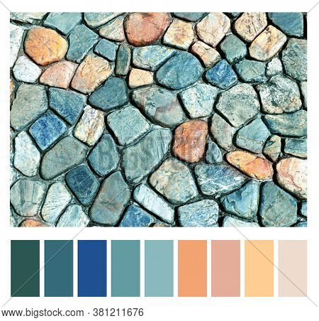 Color matching palette with complimentary colour swatches. Texture of ancient paving stone of blue, gray, red and yellow colors