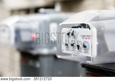 Row Of Gray Natural Gas Meters At An Apartment Complex