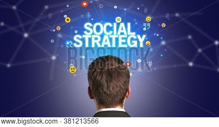 Rear view of a businessman with SOCIAL STRATEGY inscription, social networking concept