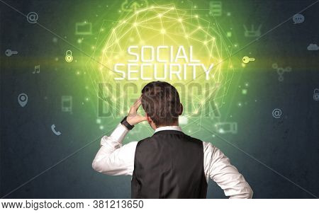 Rear view of a businessman with SOCIAL SECURITY inscription, online security concept