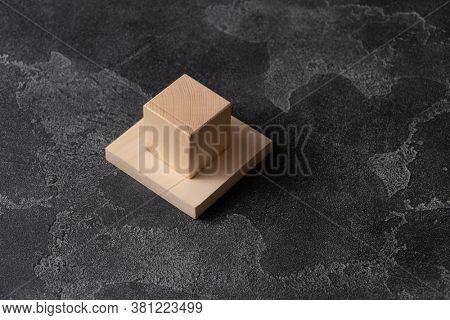 Wooden blocks on dark concrete surface.
