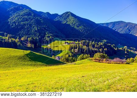 Italy, Tyrol. Picturesque Val di Funes Valley at the foot of the Dolomites in Italy. The most beautiful village in the world, Santa Maddalena. The concept of ecological, informative and photo tourism