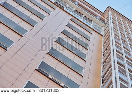 Multistorey Building. Rhythm In Photography. Multi-storey Facade, Windows And Block Of Flats, Close