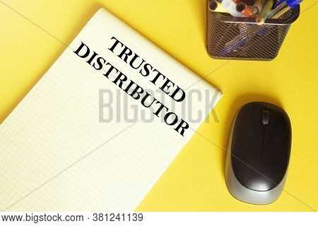 Computer Mouse, Pens, Felt-tip Pens, Notepad With Text Trusted Distributor On A Yellow Background