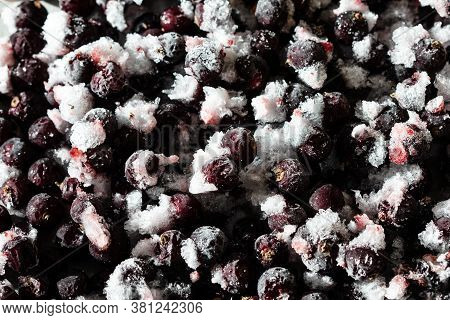 Frozen Berries Of Black Currant On A Gray Background. Storage Of Frozen Food. Frozen Product. Black