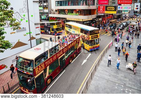 Hong Kong - March 19, 2013: Hop On Hop Off Double Decker Tourist Bus Tour In Hong Kong. Bus Is A Pop