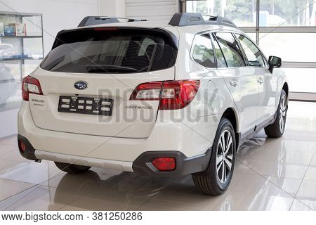 Russia, Izhevsk - August 13, 2020: New Modern Outback In The Subaru Showroom. Back And Side View.
