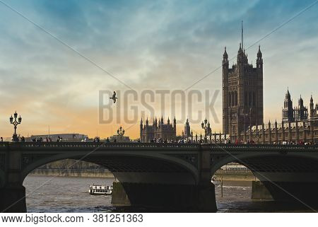 The Palace Of Westminster Along The Banks Of The Thames In Central London, Uk.