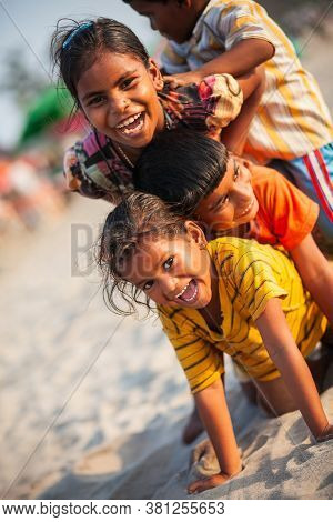 Goa, India - November 08, 2011: Unidentified Indian Children Playing At The Beach In Goa In India