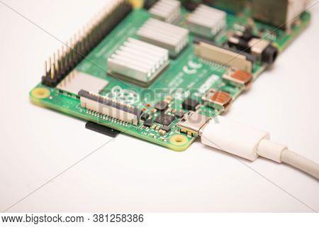 Kiev, Ukraine - August 13th, 2020: Close-up Of A Powered Raspberry Pi 4 Model-b On A White Backgroun