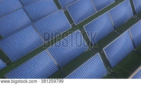 Solar Panels Or Batteries On A Green Grass Background. Construction Of A Solar Energy Production Pla