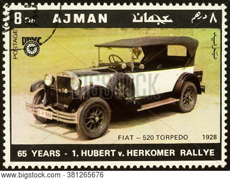 Moscow, Russia - August 17, 2020: Stamp Printed In Ajman Shows Old Car Fiat-520 Torpedo (1928), Dedi