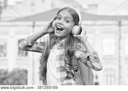 Singing Lesson. Happy Singer Outdoors. Singing Song. Little Girl Enjoy Singing To Music. Music Schoo