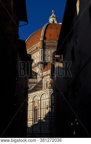 Partial View Of Santa Maria Del Fiore (st Mary Of The Flower) In Florence From A Narrow Lane, Built