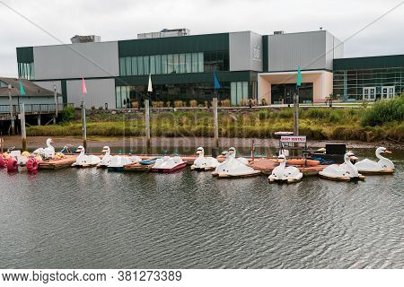Seaside, Oregon - July 31, 2020: Swan Paddleboat Boat Rentals Available, To Paddle Along The Neawann