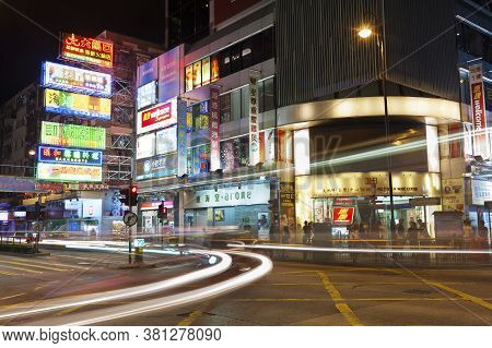 Hong Kong, China -- June 30, 2015 : Night Traffic Through Busy Street In Urban Area In Hong Kong. Wi