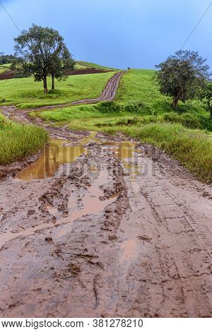 Tire Tracks On A Muddy Road In The Countryside